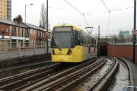 There are several parts of the Manchester Metrolink system that take advantage of climbing abilities of modern trams compared with heavy rail traction. Immediately after leaving the Eccles terminus the tracks dive under a large roundabout and climb back for street level running on the other side. 3014 enters the underpass on 28 December 2012 while operating an Eccles to Piccadilly service.  <br><br>[Mark Bartlett&nbsp;28/12/2012]