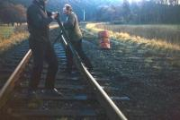 Contractors dismantle the remaining Up track of the Waverley Route in January 1972, at Crookston just north of Fountainhall. In this view looking south, the Fountainhall Up Distant signal can just be seen. The photographer recollects one of the contractors recounting how, when lifting track at Melrose some months earlier, he had been loudly berated by a local woman for taking away her railway. <br><br>[David Spaven&nbsp;/01/1972]