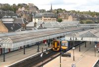 View north west over Stirling station in May 2012 from the pedestrian footbridge. Trains for Dunblane and Glasgow Queen Street are at the platforms and Stirling Castle overlooks the scene top left.<br><br>[John Furnevel&nbsp;09/05/2012]