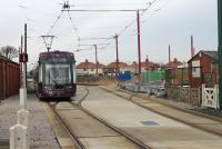 Until recently, the tramway civil engineers' sidings and yard were located at Thornton Gate.  An intricate track layout remains,  with passing loop and turnback siding, but the yard itself is now trackless and being redeveloped and the access point is redundant. <I>Flexity</I> Tram 016 passes the site of the yard as it leaves Thornton Gate for Fleetwood on 16 January.<br><br>[Mark Bartlett&nbsp;16/01/2013]