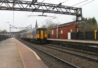 Although now reduced to two platforms Guide Bridge is still a busy spot with junctions at each end of the station. It sees frequent Trans Pennine services, Northern DMUs and EMUs and also freight traffic. 150271 pulls away on a service to Rose Hill via Hyde. The old platforms, off to the left of the picture [see image 20150], are now filled in.  <br><br>[Mark Bartlett&nbsp;28/12/2012]