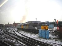 Devon & Cornwall Railway Company's 56311, coupled to ex Jarvis Rail 56301 in sidings alongside Derby Station south junction, emits an initial burst of 'clag' just after being started up on a cold and frosty 15 January morning. <br><br>[David Pesterfield&nbsp;15/01/2013]