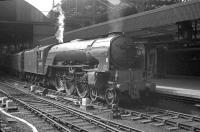 An undated photograph showing A1 Pacific no 60115 <I>Meg Merrilies</I> with a train at Newcastle Central. The locomotive spent the first 12 of its 14 operational years at Gateshead, with the last two at Leeds, Copley Hill, from where it was finally withdrawn in November 1962.  <br><br>[K A Gray&nbsp;//]