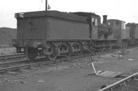 A further shot of J21 0-6-0 no 65099 with D2053 in the works reception sidings at Darlington shed in late 1961  [see image 41693]. The lengthy period between the J21's withdrawal from Tyne Dock in October 1961 and cutting up at Darlington in February 1966 was due to the locomotive having been initially earmarked for preservation. Unfortunately further examination within the works led to a rethink and the J21 example finally chosen for preservation was 65033.<br><br>[K A Gray&nbsp;//1961]