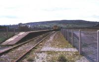 Basic facilities at Colne in August 1977 looking south west towards Nelson. The station was by then a terminus, with the through line to Skipton (behind the camera) having closed in 1970 [see image 38798].<br><br>[Ian Dinmore&nbsp;/08/1977]