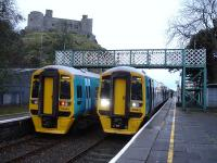 158818 and 158822 during extended stops at Harlech on 21 November, after bringing students to the local college. The trains are standing below Harlech Castle while awaiting their 08.25 departures to Birmingham International and Pwllheli respectively. <br><br>[David Pesterfield&nbsp;21/11/2012]