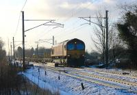 Early DBS/EWS Class 66 No. 66003, now in its 15th year of service, heads an infrastructure train north on the WCML at Brock. The early sun was already thawing the overnight snow as this train followed the preceding steam special.<br><br>[Mark Bartlett&nbsp;26/01/2013]