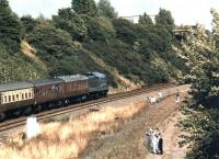 4468 <I>Mallard</I> runs past the site of Thornhill station near Dewsbury heading east towards Wakefield in July 1988 on one of its 50th Anniversary Celebration workings. <br><br>[David Pesterfield&nbsp;31/07/1988]