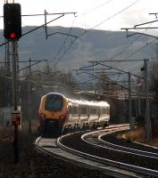 A southbound voyager passes the former junction and station at Symington in January 2013. The former route to Broughton and Peebles diverged to the left. This view is from a location to the north of the station site.<br><br>[Ewan Crawford&nbsp;06/01/2013]