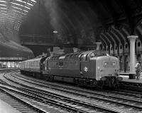 The soaring train sheds of the Victorian era had the practical feature of not trapping smoke at platform level - something which also proved useful during the Deltic era! No. 55001 'St Paddy' arrives at York with the Sunday 09.50 Kings Cross to Edinburgh on 4 July 1976, a dated train hence the use of Mk 1 stock.<br><br>[Bill Jamieson&nbsp;04/07/1976]