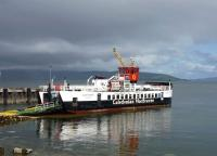 Passengers arriving at Brodick off the Ardrossan Ferry [see image 41893] can reach Kintyre following a 14 mile road trip north to link with the Lochranza - Claonaig Ferry. MV <I>Loch Riddon</I> boards at Lochranza Pier on 18 July 2011.<br><br>[John Steven&nbsp;18/07/2011]