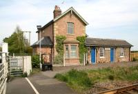 The old station at Hessay on the Harrogate - York line in April 2009. The building is now a private house, although the annexe on the left provides accommodation for the signalman / crossing keeper, whose levers and instruments are located on the platform.<br><br>[John Furnevel&nbsp;24/04/2009]