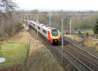 A Super Voyager heads north along the WCML towards Penrith. The train has just passed under the A6 road in Clifton village and is now crossing the M6 Motorway. The long closed station was some distance south of the village.<br><br>[Mark Bartlett&nbsp;04/02/2013]