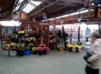 Anyone here called Buster? Even the flower stall at Moor Street is pleasantly old-fashioned. Notice the steam engine to the right of the 'shed'.<br><br>[Ken Strachan&nbsp;09/11/2012]