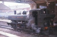 0-6-0PT no 1638 stands under the station roof at Ashburton on the Dart Valley Railway in January 1971. Services to Ashburton ceased in October that year to facilitate improvements to the A38 trunk road, which now incorporates part of the trackbed between Buckfastleigh and Ashburton.