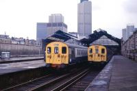 Two North London Line trains stand at Broad Street in 1986, the year the station finally closed. The site subsequently became home to the Broadgate Centre, at that time London's largest office development.<br><br>[Ian Dinmore&nbsp;//1986]