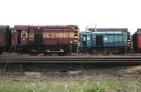 A pair of class 08 shunters in the north sidings at Motherwell shed in February 2006, with 08402 in EWS livery and 08927 in BR colours. No 08402 (formerly D3517) was eventually cut up at T J Thomson, Stockton, in March 2010, while  08927, built at Horwich in 1962 as D4157, had better luck and is now preserved at NRM Shildon. [See image 40691]. <br><br>[John Furnevel&nbsp;25/02/2006]