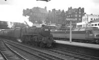 Polmadie's Standard class 5 4-6-0 no 73059 arrives at Carlisle from the north on 30 July 1966 with an unidentified working. Brush Type 4 no D1976 (delivered new to Haymarket the previous November) is standing in the bay. <br><br>[K A Gray&nbsp;30/07/1966]