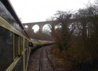 This is Moorswater viaduct, seen from Moorswater, and not to be confused with Liskeard viaduct [see image 29447]. The train is the Pathhfinder Tours <I>Hullaba-Looe</I> on 10 February 2013. One of the piers for the earlier timber viaduct can be seen above the second coach.<br><br>[Ken Strachan&nbsp;10/02/2013]