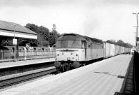 47188 accelerates west through Ealing Broadway platform 3 in 1981 after bringing a trainload of containers off the North London Line at Acton Wells Junction. A Central Line train is awaiting its departure time at platform 6. <br><br>[John Furnevel&nbsp;29/04/1981]