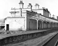 By the end of the 1970s / early 1980s when this photograph was taken, the fine range of buildings at Halifax no longer served the needs of passengers and was boarded up, presenting a less than appealing image of the railway. Since then it has been restored with part of it in use as a nursery. <br><br>[Bill Jamieson&nbsp;//]