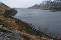 A northbound Sprinter is just about to enter Loch Treig Tunnel on the deviation. The deviation begins close to the bend in the line in the background with the original line now flooded when the reservoir is full. In the background right are the valve shafts for the pipeline to the Locaber Smelter, that location being the eastern terminus of the Lochaber Narrow Gauge Railway.<br><br>[Ewan Crawford&nbsp;11/02/2013]