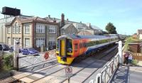 An East Midlands Trains 158 on Attleborough level crossing, Norfolk, in May 2011 with a Norwich - Liverpool Lime Street service. View is south west towards Ely.<br><br>[Ian Dinmore&nbsp;/05/2011]