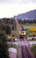 Looking south from the top of the Aviemore Up distant signal on the line from Boat of Garten in July 1991 when the assistance of a rail mounted crane was sought to erect a telegraph pole next to Dalfaber level crossing.<br><br>[John McIntyre&nbsp;/07/1991]