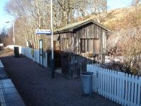 Beasdale Station's rustic waiting shelter located on the up side platform caught on camera during a station call at this request stop on 20 February.<br><br>[David Pesterfield 20/02/2013]