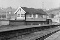 While the rest of the station buildings at Halifax were semi-derelict in the late '70s/early '80s, the signal box still looked spick and span, albeit it was located on the trackless western island platform. <br> <br><br>[Bill Jamieson&nbsp;//]