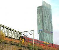 An East Midlands Train passing over Castlefield Viaduct (Ordsall Lane) Manchester in September 2009 under the shadow of the 47-storey Beetham Tower.<br><br>[Ian Dinmore&nbsp;/09/2009]
