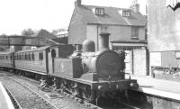 Adams class O2 0-4-4T no 30 <I>'Shorwell'</I> stands with a train at Cowes, Isle of Wight, on 16 August 1961. Cowes station was closed in 1966, a supermarket now occupies the site.  <br><br>[K A Gray&nbsp;16/08/1961]