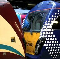 Contrasting colour schemes at Waverley on 24 February. A pair of ScotRail 334 units with a TransPennine 185 behind.<br><br>[Bill Roberton&nbsp;24/02/2013]