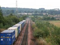 Containers bound for Aberdeen leave Grangemouth in September 2006. The train will join the main line at Grangemouth Junction, just east of Falkirk Grahamston station. [See image 35008]<br><br>[John Furnevel&nbsp;21/09/2006]