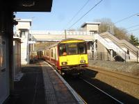 318263 runs under the new footbridge at Hyndland station on 18 February with the 12.31 service to Airdrie. <br><br>[David Pesterfield&nbsp;18/02/2013]