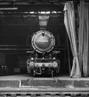 From the looks of the curtains the Putzfrau (cleaning lady) at Wanne-Eickel depot in the Ruhr has been neglecting her duties! A 3 cylinder 2-10-0 contributes to the murk as it whiles away a Saturday afternoon in August 1975 on one of the stabling roads inside the shed, which was accessed via a traverser.<br><br>[Bill Jamieson&nbsp;30/08/1975]