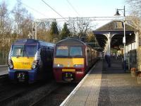 320312 prepares to leave Milngavie with the 16.12 for Motherwell on 18 February as 334023 waits at platform 2 with the 16.23 limited stop service to Edinburgh.<br><br>[David Pesterfield&nbsp;18/02/2013]