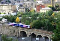 A Manchester Victoria service entering Halifax station from Beacon hill viaduct in September 2009.<br><br>[Ian Dinmore&nbsp;/09/2009]