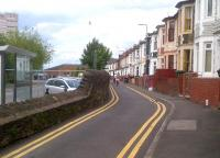 In contrast to Cardiff Road [see image 39471], here in Ebenezer Terrace, with its brightly colured houses, the narrow bit on the right was the road; and the broad bit on the left was the railway. View looks North and slightly East, towards the River Usk in June 2012; the junction would be perhaps sixty feet behind the photographer. The junction was named after a pub; the standard local salutation being 'Awrightabutt', which might not do as the name of a junction.<br><br>[Ken Strachan&nbsp;20/06/2012]