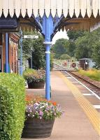 Platform scene at Lingwood station, Norfolk, on the line between Norwich and Great Yarmouth, on a warm summer's day in June 2010. The view is east towards the level crossing over Station Road.<br><br>[Ian Dinmore&nbsp;/06/2010]