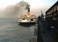 The BR Paddle Steamer <I>Lincoln Castle</I> about to leave New Holland Pier in 1975 with the Humber Ferry bound for Hull. [See image 31915]<br><br>[Ian Dinmore&nbsp;//1975]