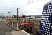 The buffers at Ardrossan Harbour, and a Class 380 newly arrived from Glasgow. Prior to 1987 when this station opened the line continued a short distance to the station at Ardrossan Winton Pier.<br><br>[Mark Bartlett&nbsp;08/03/2013]