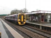 The ever versatile Class 158s tend to be associated with longer distance, semi-express services but on 8th March 2013 Haymarket's 158734 was rostered to the Motherwell - Cumbernauld shuttle and is seen here arriving at the latter station. A single DMU is able to provide an hourly service in each direction on this diagram. [See image 21344] for the same view nearly 50 years earlier. <br><br>[Mark Bartlett&nbsp;08/03/2013]