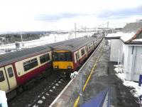 Trains to and from Lanark passing at a snowy Carluke station on 12 March 2013.<br><br>[John Yellowlees&nbsp;12/03/2013]