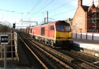 Although it was a sunny afternoon, the temperature at Wigan North Western on 11 March was around freezing when the windchill factor was taken into account. Here DBS 60011 heads south through the station with the 6G42 Carlisle to Warrington gypsum boxes. <br><br>[John McIntyre&nbsp;11/03/2013]