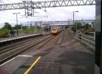 A down Pendolino about to pass Nuneaton platform 3 at full line speed. The damaged up end of the platform is clearly visible 38 years on from the crash [see image 41807].<br><br>[Ken Strachan&nbsp;13/07/2012]