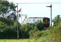 A DMU about to cross Somerleyton swing bridge in September 2004 on its way from Lowestoft to Norwich.<br><br>[Ian Dinmore&nbsp;08/09/2004]