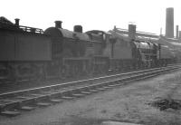 Fowler 2P 4-4-0 no 40585 languishes in the sidings alongside Nottingham shed (16A) in May 1961, some 3 months after official withdrawal by BR.<br><br>[K A Gray&nbsp;13/05/1961]