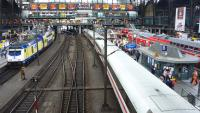Looking over the main platforms at Hamburg in July 2010. On the left a Metronom train awaits its departure time, in the centre of the photograph an ICE service snakes away westwards, while to the right two DB trains are departing in opposite directions.<br><br>[John Steven&nbsp;27/07/2010]