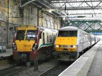 Contrasting electric traction at Edinburgh Waverley on 12 March 2013.<br><br>[Bill Roberton&nbsp;12/03/2013]